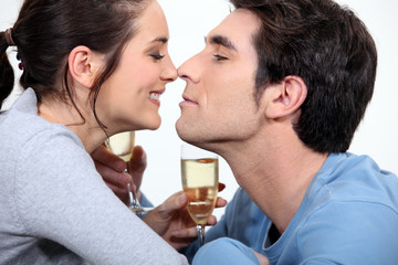 couple with flute of champagne canoodling