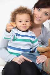 Boy eating cookies.