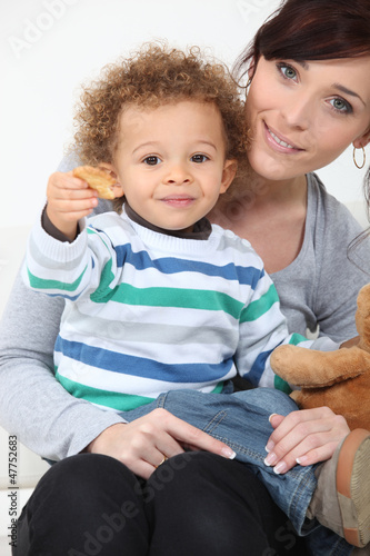 Boy eating cookies.