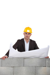 Architect looking over wall