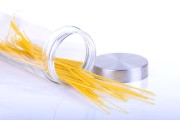 Delicious Pasta in Glass Jar on white