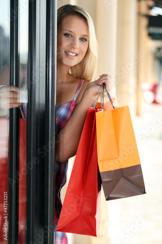 Woman entering a store