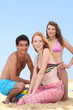 Three teenagers on the beach