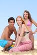 Three teenagers on the beach