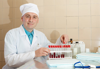 male nurse works with blood sample in  laboratory