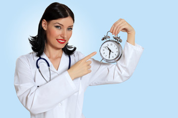 Young female doctor with clocks