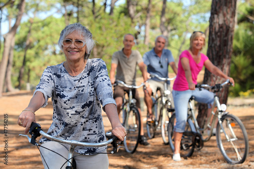 Senior woman and her friends riding bikes