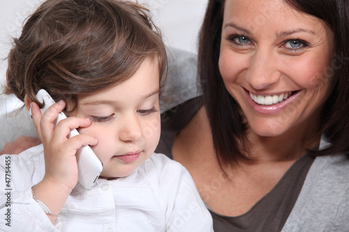 Mother and daughter with mobile telephone