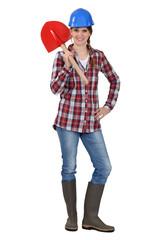 Tradeswoman holding a spade