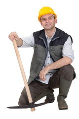 Construction worker with a pickaxe.