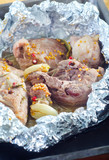 baked meat in the foil