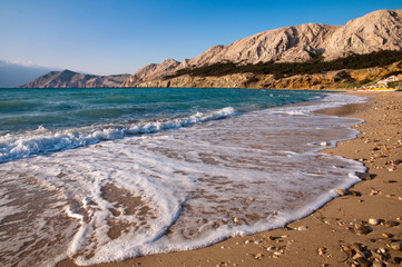 Beach at Baska with foam sea wave in Krk - Croatia