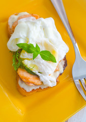 Close Up of Poached Delicious Egg with Whole Grain Bread