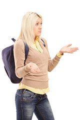 Blond female student with backpack gesturing - I do not know