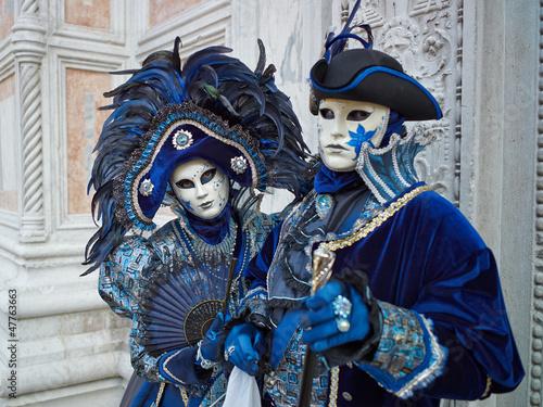 Leinwanddruck Bild Person in Venetian costume attends Carnival of Venice.