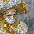 canvas print picture - Person in Venetian costume attends Carnival of Venice.
