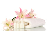 Fototapety beautiful lily with towel and bottles isolated on white