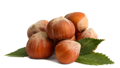 tasty  hazelnuts with leaves, isolated on white
