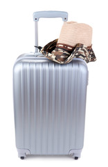 Silver suitcase with  hat  isolated on white