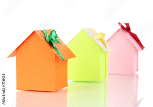 Small houses with ribbons isolated on white