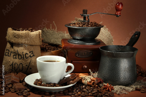cup of coffee, grinder, turk and coffee beans