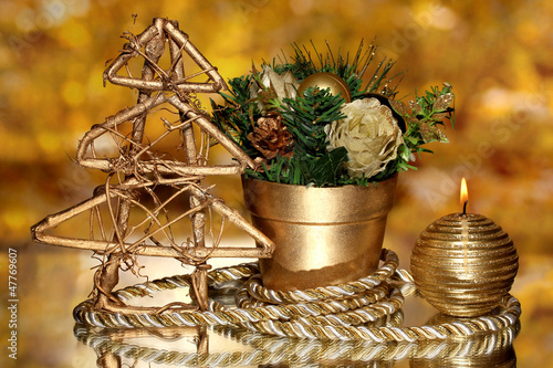 Christmas composition  with candles and decorations in gold