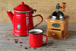 Cup of cofee with rustic coffee pot