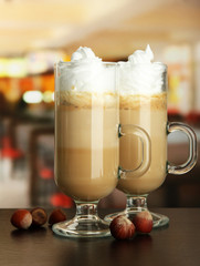 Fragrant coffee latte in glasses cups with nuts,