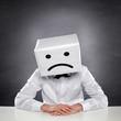 Unhappy Man with Box