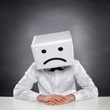 Unhappy Man with Box
