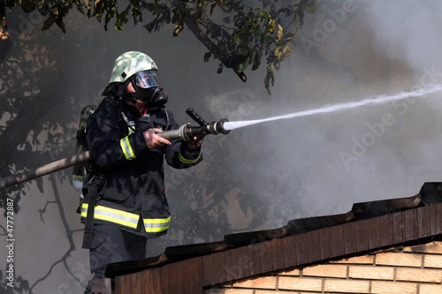 Fireman on the roof in a smoky environment