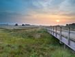 Wooden bridge during sunrise