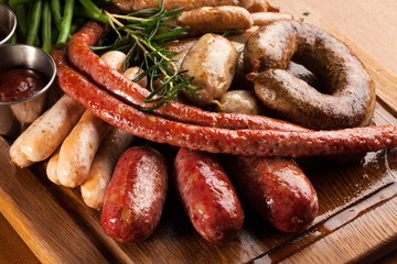 Assortment of grilled sausages.