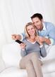 Cheerful couple watching TV