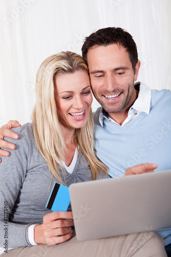 Couple having fun shopping online