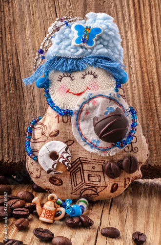 "Handmade Rag doll ""Coffee fairy"" on wooden background"