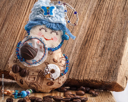 Handmade Rag doll on wooden background