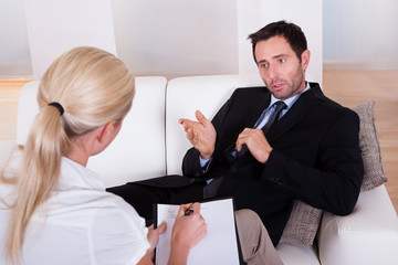 Man talking to his psychiatrist