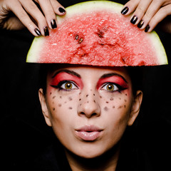 Young beautiful woman and watermelon portrait