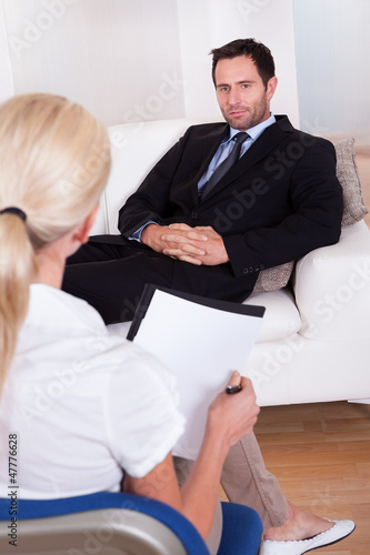 A middle aged smart male executive interviewing