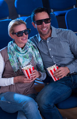 Lovely couple watching a 3d movie