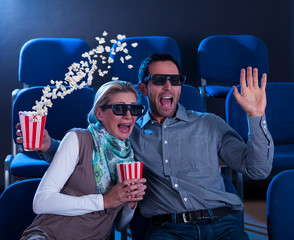 Couple reacting in shock to a 3D movie