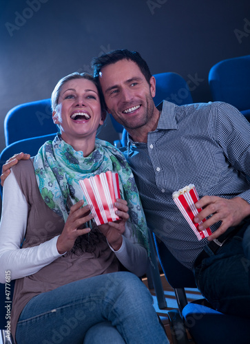 Stylish couple enjoying a movie