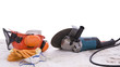 angle grinder and protective equipment on dust sheet