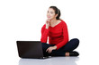 Happy young woman using her laptop
