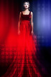 Woman in elegant red dress with American flag
