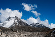 Summit and clouds near Sacred Lake of Gokyo in Himalayas