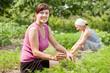 women  in field of carrot