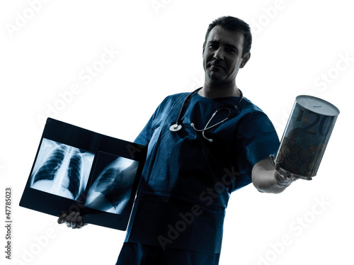 doctor surgeon radiologist holding a money box