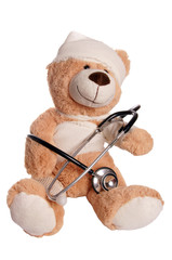 Teddy bear with stethoscope and bandage